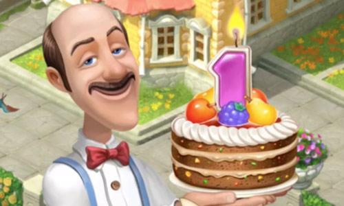1周年お祝いケーキを手に微笑むオースティン:ガーデンスケイプ(Gardenscapes)