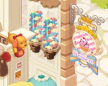 看板のカップケーキや「キャンディー自販機」に興味津々の子犬(どきどきレストラン)