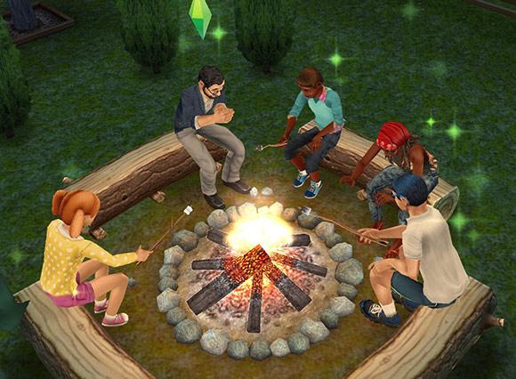 キャンプファイヤーで楽しそうに焼きマシュマロを食べるシムたち(The Sims フリープレイ)