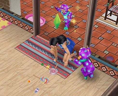 大発生のキャンディーモンスターとキャンディーを拾い集めるシム(The Sims フリープレイ)