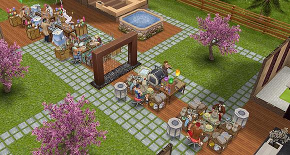 シムタウン・ヘルススパ住宅の中央に並べられた工作セットで、工作に励むシムたち(The Sims フリープレイ)