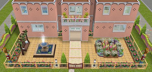 門、噴水、花壇のある正面玄関(The Sims フリープレイ)