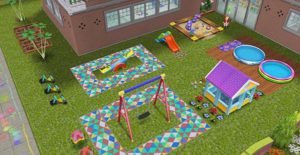 原色の三角形のラグ、こどもハウス、ブランコセット、子供用プール、虹のシーソー、砂場、滑り台、大きな三輪車などをレイアウトした中庭プレイグラウンド(The Sims フリープレイ)