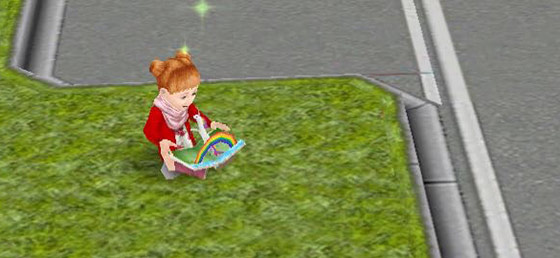 車道脇の芝生で飛び出す絵本を楽しむ幼児シム(The Sims フリープレイ)