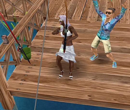 かかった魚を釣り上げようと盛り上がるシムたち(The Sims フリープレイ)