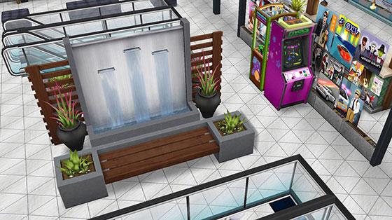 暗色の水壁、グレーのリゾートベンチ、アーケードゲーム、クレーンゲームなどを配置した、アイスホッケースタジアム2階ロビー(The Sims フリープレイ)