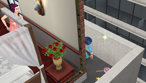 ペントハウスの隅でキャンディーを拾うシム(The Sims フリープレイ)
