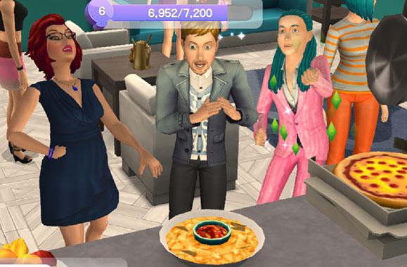 パーティーのごちそうの前で盛り上がるシムたち(The Sims シムズ ポケット)