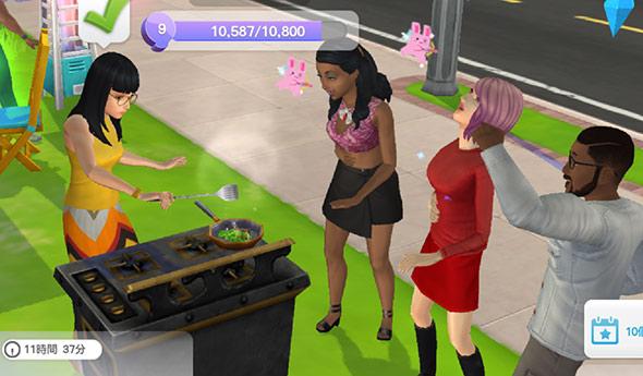 パーティーで野外クッキングを楽しむシムたち(The Sims シムズ ポケット)