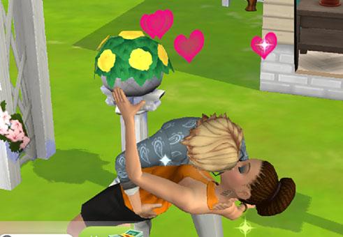 結婚式オブジェクトの前で、熱いキスに夢中になる、ノア君とヘイリーさん(The Sims シムズポケット)